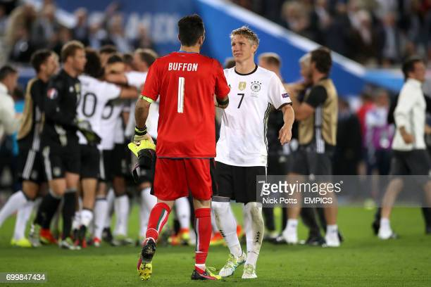 Italy goalkeeper Gianluigi Buffon shakes hands with Germany's Bastian Schweinsteiger after the game