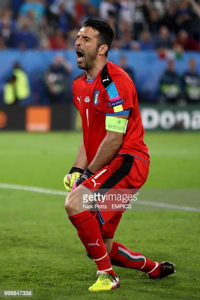 Italy goalkeeper Gianluigi Buffon shows his dejection after losing in the penalty shootout