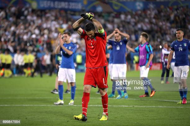 Italy goalkeeper Gianluigi Buffon stands dejected with teammates after the game