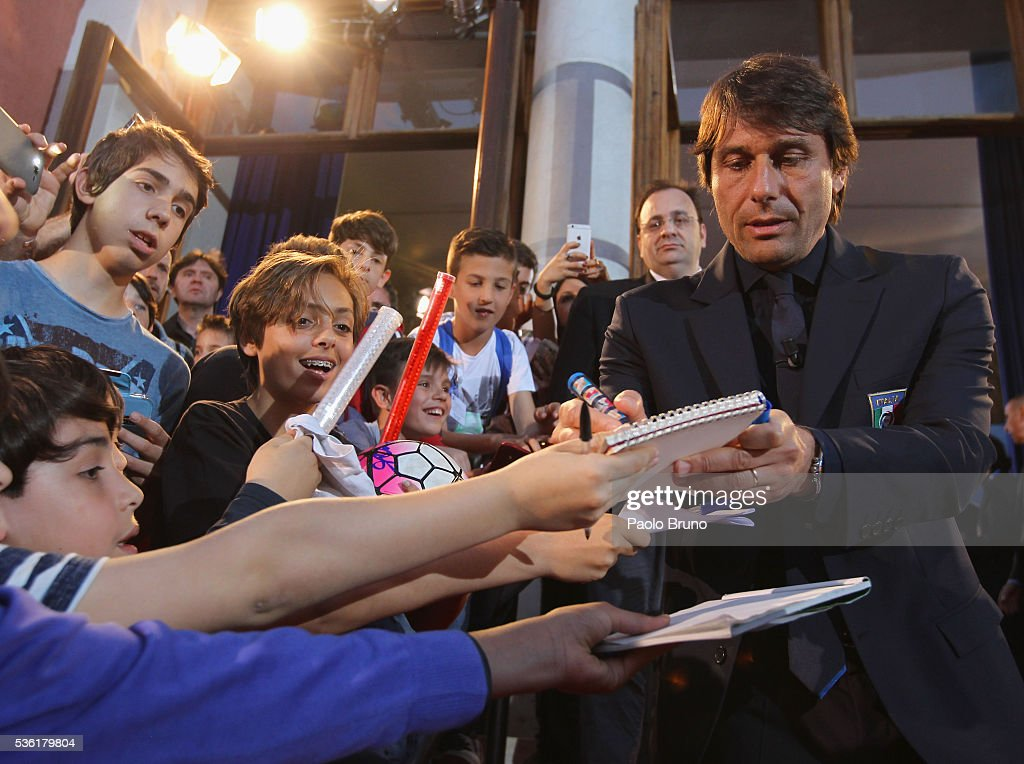 Italy head coach <a gi-track='captionPersonalityLinkClicked' href=/galleries/search?phrase=Antonio+Conte&family=editorial&specificpeople=2379002 ng-click='$event.stopPropagation()'>Antonio Conte</a> signs the autographs before the 'Sogno Azzurro' TV programme at Auditorium del Foro Italico on May 31, 2016 in Rome, Italy.