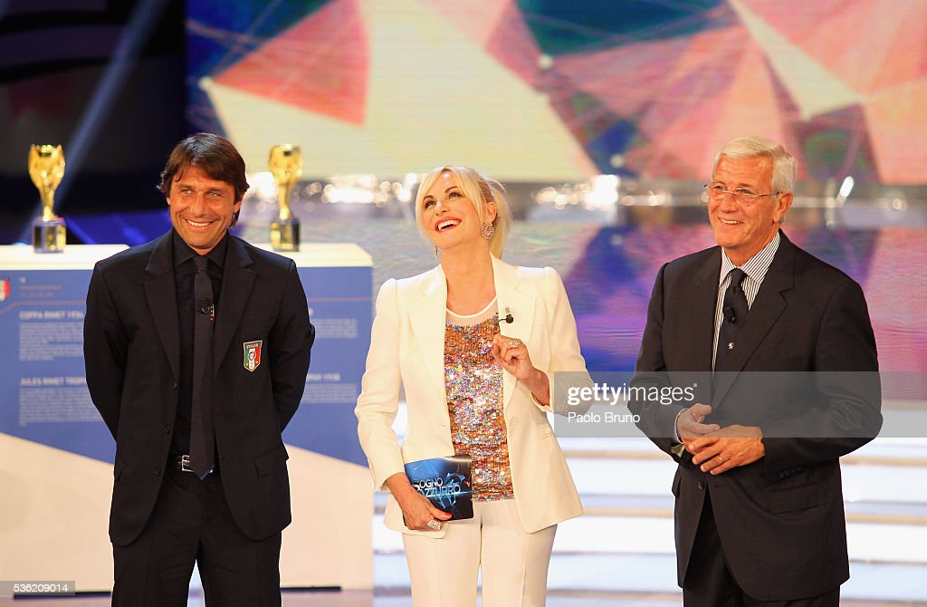Italy head coach <a gi-track='captionPersonalityLinkClicked' href=/galleries/search?phrase=Antonio+Conte&family=editorial&specificpeople=2379002 ng-click='$event.stopPropagation()'>Antonio Conte</a>, Tv presenter <a gi-track='captionPersonalityLinkClicked' href=/galleries/search?phrase=Antonella+Clerici&family=editorial&specificpeople=2544073 ng-click='$event.stopPropagation()'>Antonella Clerici</a> and the former Italy head coach <a gi-track='captionPersonalityLinkClicked' href=/galleries/search?phrase=Marcello+Lippi&family=editorial&specificpeople=535060 ng-click='$event.stopPropagation()'>Marcello Lippi</a> attend the 'Sogno Azzurro' TV programme at Auditorium del Foro Italico on May 31, 2016 in Rome, Italy.