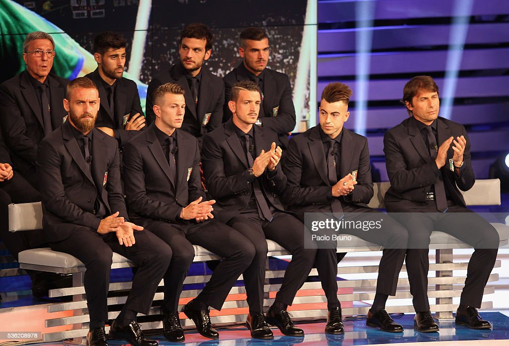 Italy head coach <a gi-track='captionPersonalityLinkClicked' href=/galleries/search?phrase=Antonio+Conte&family=editorial&specificpeople=2379002 ng-click='$event.stopPropagation()'>Antonio Conte</a> (R) with his players attend the 'Sogno Azzurro' TV programme at Auditorium del Foro Italico on May 31, 2016 in Rome, Italy.
