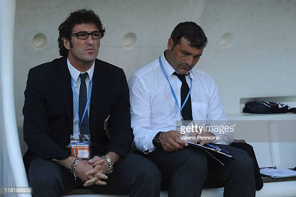 Italy head coach Ciro Ferrara and Angelo Peruzzi sit on the bench prior to the Toulon U21 tournament match between Italy and Portugal at Stade de...