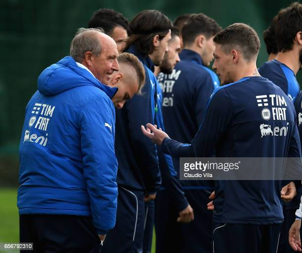 Italy head coach Gian Piero Ventura and Andrea Belotti chat during the training session at the club's training ground at Coverciano on March 23 2017...