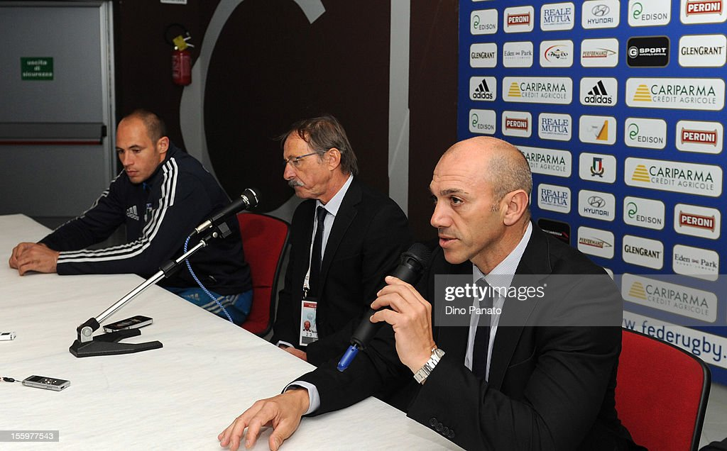 Italy head coach Jacques Brunel (C) speak to the media during a press conference with Sergio Parisse (L) after the international test match between Italy and Tonga at Mario Rigamonti Stadium on November 10, 2012 in Brescia, Italy.