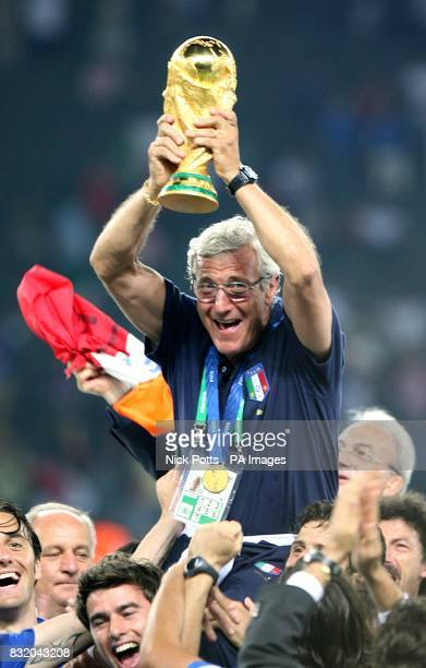 Italy head coach Marcelo Lippi lifts the trophy