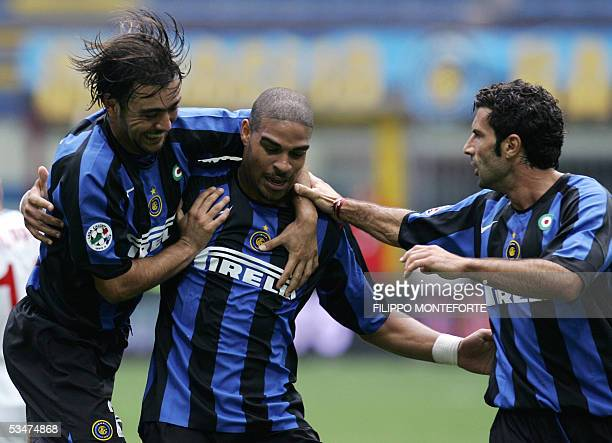 Inter Milan Adriano of Brazil celebrates with his teammates Alvaro Recoba of Uruguay and Figo of Portugal after scoring his first goal during their...