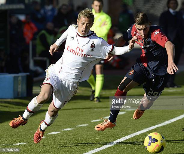 CAGLIARI Italy Japanese midfielder Keisuke Honda of AC Milan competes for the ball with Cagliari's Nicola Murru in a Serie A match on Jan 26 at...