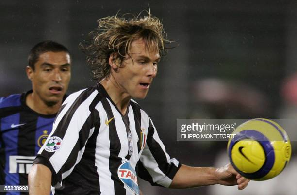 Juventus Pavel Nedved of Czech Republic controls the ball in front of Ivan Cordoba of Inter Milan during their Serie A football match in Turin's...