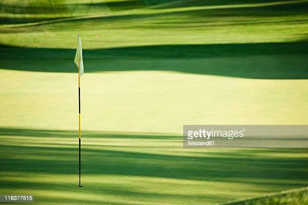 Italy, Kastelruth, Golf flag on golf course