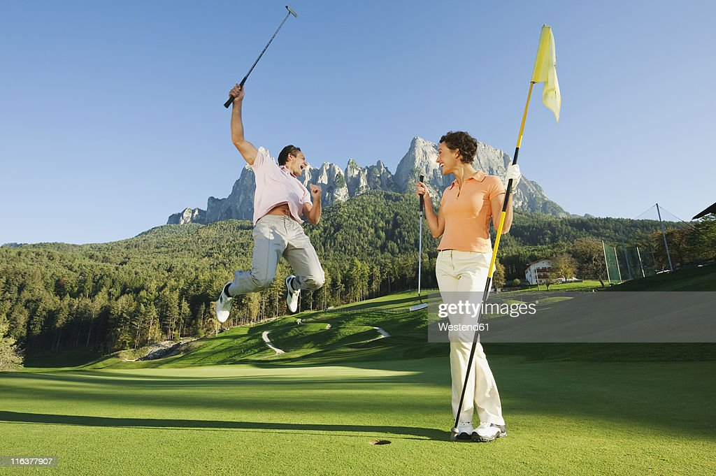 Italy, Kastelruth, Golfers on golf course : Stock Photo