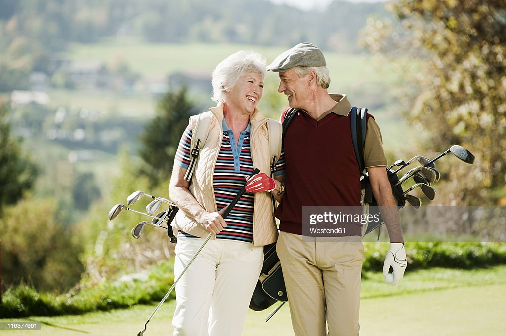 Mature couple and golf