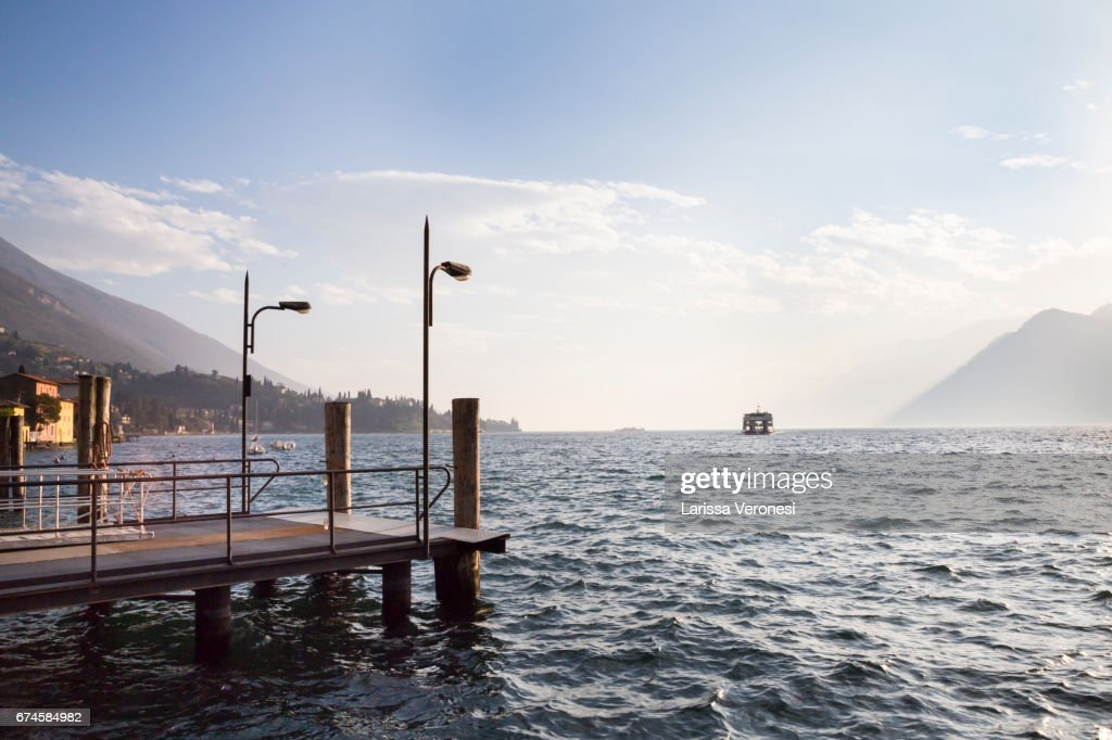 Italy, Lake Garda, Malcesine, Harbor with ferry boat at sunset : Stock-Foto