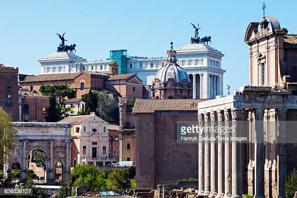 Italy, Lazio, Rome, Roman Forum and Monument of Vittorio Emanuele II against blue sky