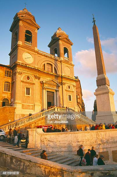 Italy Lazio Rome Trinita dei Monti sixteenth century church at the top of the Spanish Steps at sunset with tourist crowds