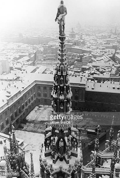 Italy Lombardia Milano View from the roof of Milan Cathedral in the winter of one of its spires against the backdrop of the city undated probably...
