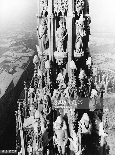 Italy Lombardia Milano View from the roof of Milan Cathedral of one of its spires against the backdrop of the city undated probably 1934 Photographer...
