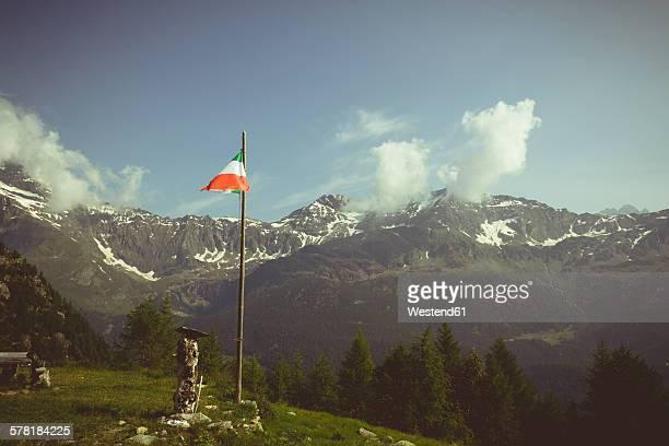 Italy, Lombardy, Chiesa in Valmalenco, Italian flag, alpine landscape