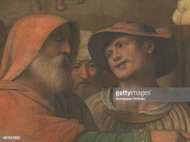 Italy Lombardy Como Como Cathedral Detail A young man looking at an old man who is pointing at the holy worshipping of the Wise Men