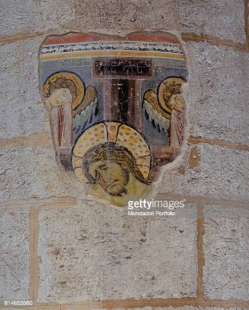 Italy Lombardy Milan Basilica di Sant'EustorgioThe face of the crucified Christ under two angels on the sides
