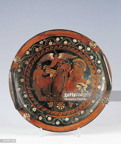 Italy Lombardy Milan Civico Museo Archeologico All Apulian redfigured phiale Eros gives a garland to a bridegroom The bridegroom gives another one to...