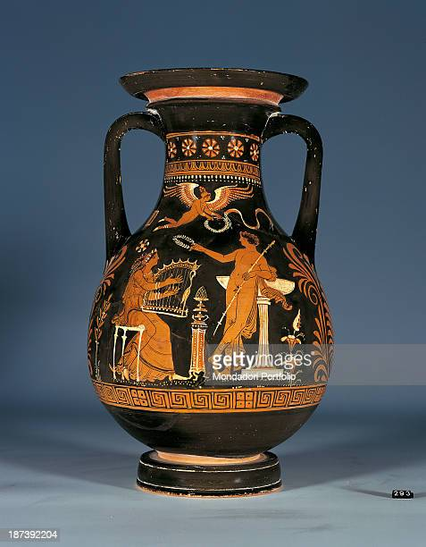 Italy Lombardy Milan Civico Museo Archeologico All Apulian redfigured pelike A boy gives a laurel garland to a girl who is playing the lyre