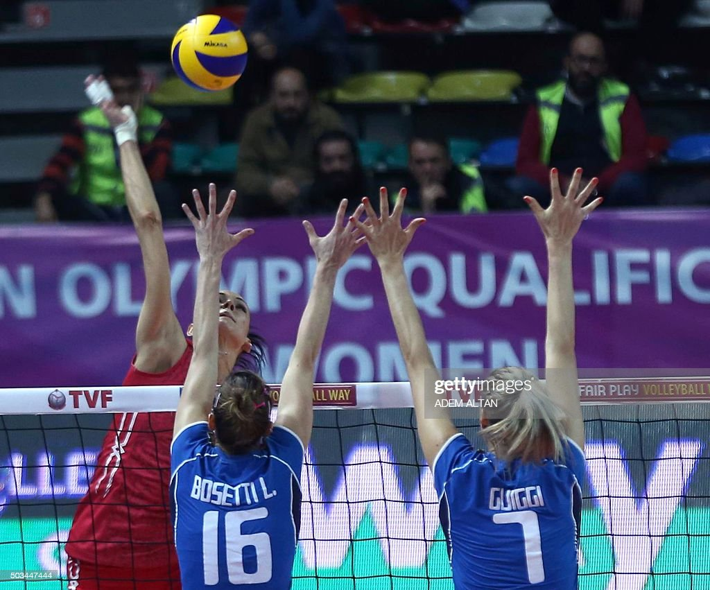 Italy Lucia Bosetti and Martina Guiggi attempt to block during the Women's European Olympic Qualification volleyball match against Russia on January...