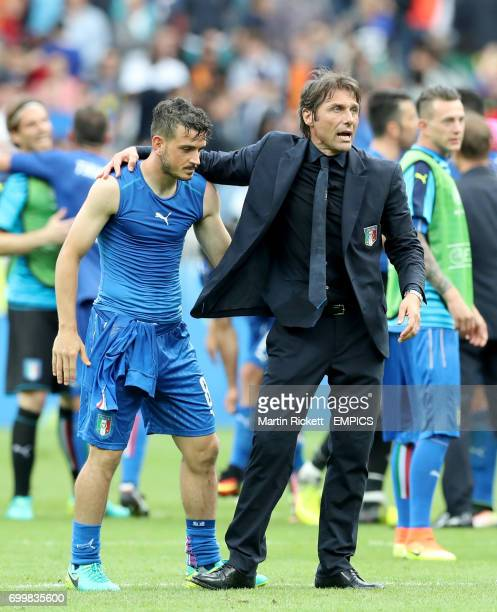 Italy manager Antonio Conte and Alessandro Florenzi celebrate victory after the match