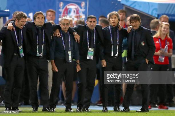 Italy manager Antonio Conte and his backroom staff react during the penalty shootout