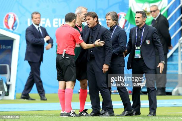 Italy manager Antonio Conte argues with referee Cuneyt Cakir on the touchline