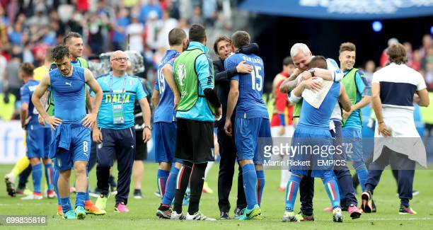 Italy manager Antonio Conte hugs Andrea Barzagli as they celebrate victory after the match