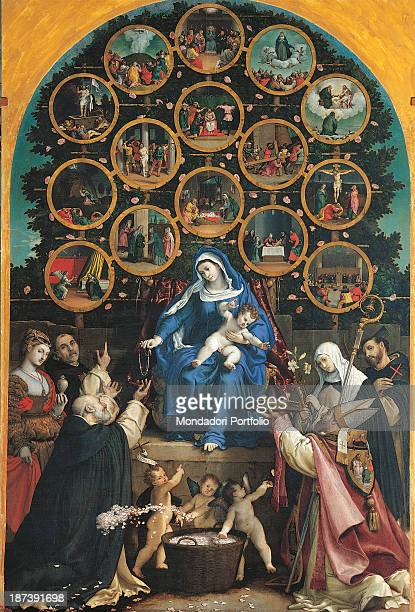Italy Marche Cingoli Pinacoteca Civica The Virgin Mary in blue dress sitting on the throne with the Child Jesus give a crown to St Dominic the old...