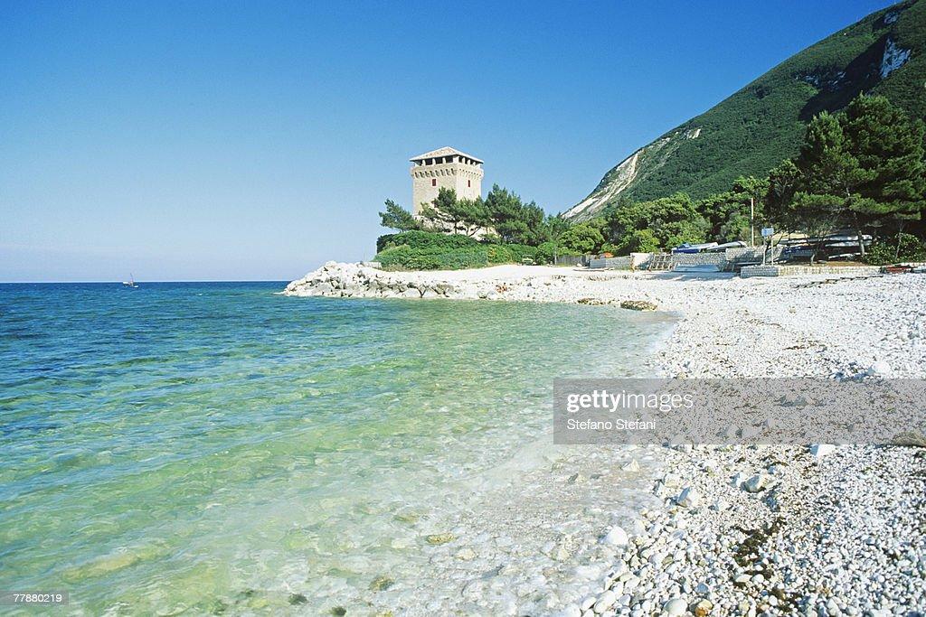 Italy, Marche, Conero, Torre di Portonovo at seashore : Stock Photo