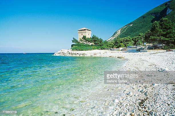 Italy, Marche, Conero, Torre di Portonovo at seashore