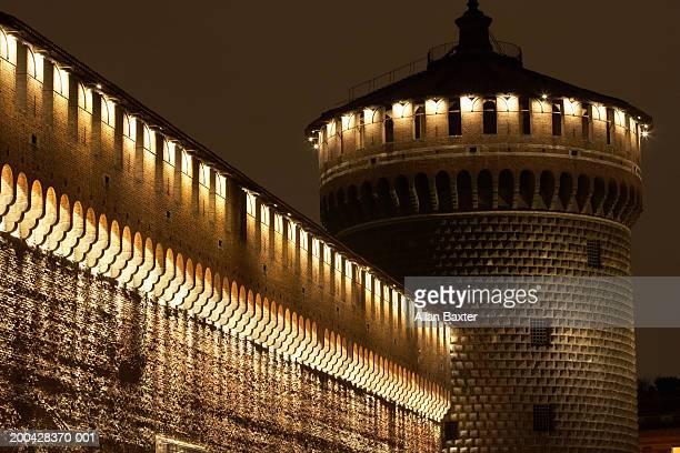 Italy, Milan, Castello Sforzesco tower, illuminated at night