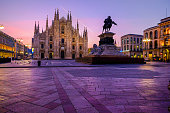 Italy, Milan, Cathedral with equestrian statue Vittorio Emanuele II in the morning