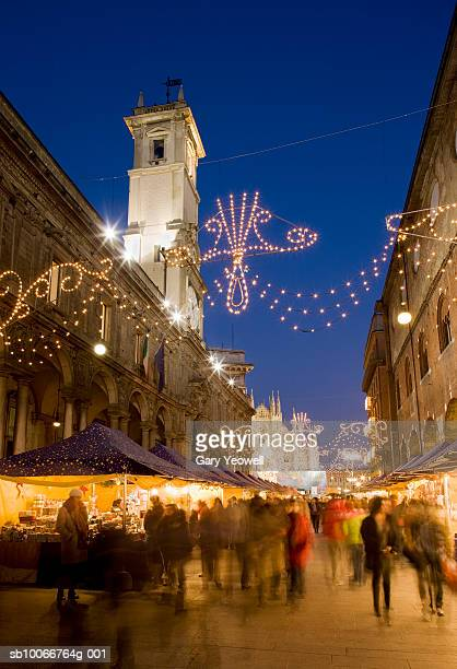 Italy, Milan, street market at dusk, blurred motion