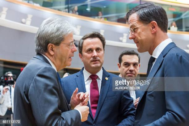 Italy Minister of Foreign Affairs Paolo Gentiloni talks with Luxembourg Prime Minister Xavier Bettel and Dutch Prime Minister Mark Rutte on the...