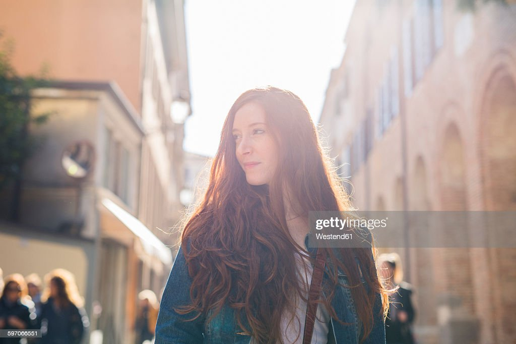 Italy, Padua, woman outdoors at sunset