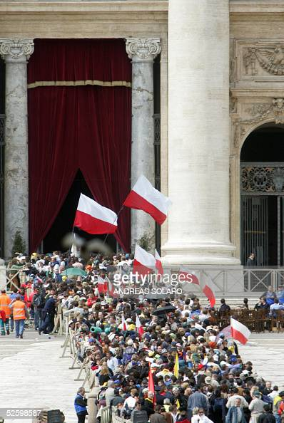 people with Polish flags line up to say goodbye to the late pontiff in St Peter's Basilica where Pope John Paul II liesinstate 07 april 2005 in the...