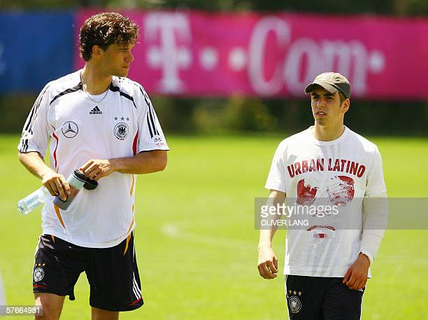 Philipp Lahm of Germany's national football team walks past his team's captain Michael Ballack as they arrive for a training session 20 May 2006 at...