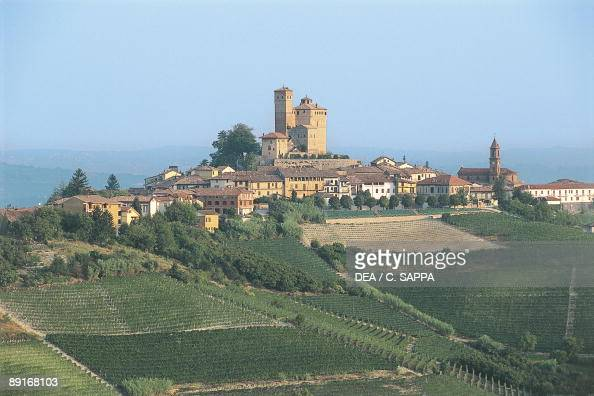 Italy Piedmont region castle of Serralunga d'Alba and town surrounded by vineyards