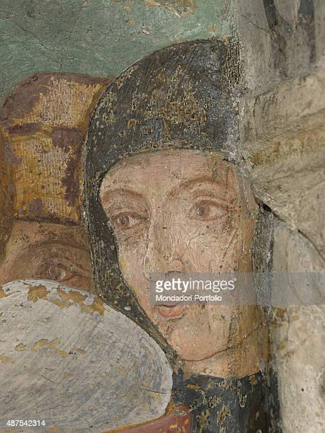 Italy Piedmont Serralunga di Crea Santuario della Madonna di Crea Detail A man looking at Saint Margaret of Antioch undergoing the trial by fire