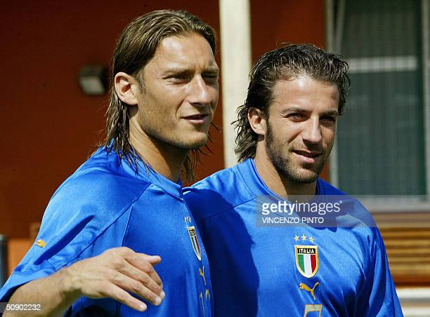 Italy player Francesco Totti poses together with Alessandro Del Piero during a photo session at Coverciano training camp near Florence 27 May 2004...