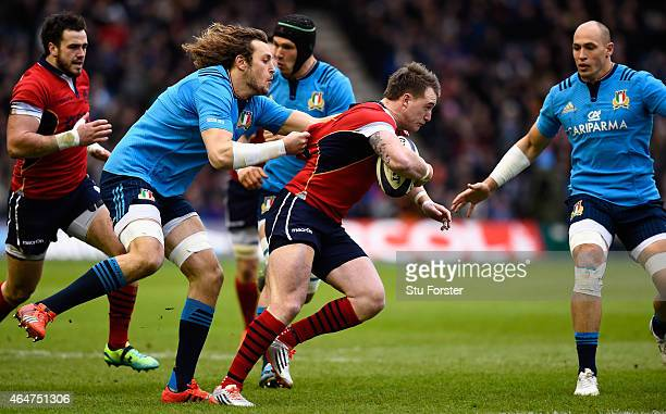 Italy player Joshua Furno grabs hold of Scotland full back Stuart Hogg during the RBS Six Nations match between Scotland and Italy at Murrayfield...