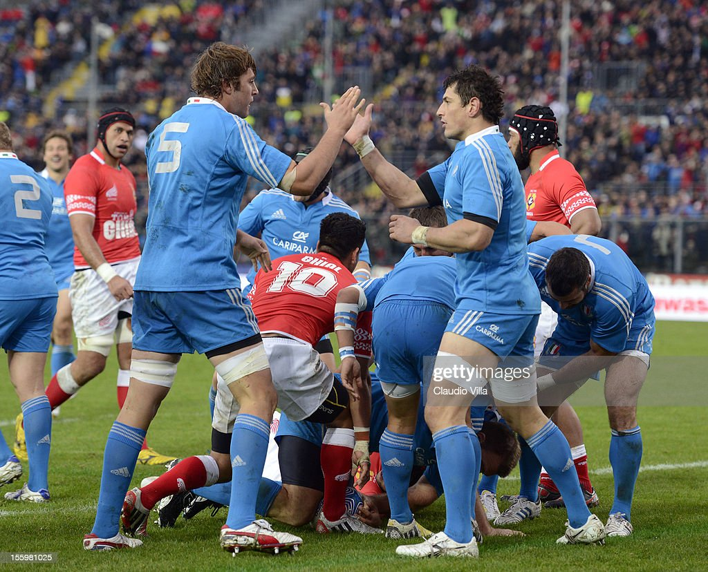 Italy players celebrate after scoring a first try during the international test match between Italy and Tonga at Mario Rigamonti Stadium on November 10, 2012 in Brescia, Italy.