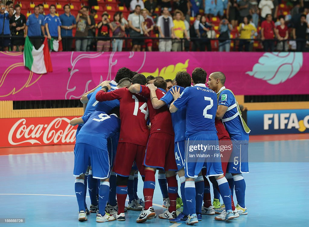 Italy players celebrate after winning the FIFA Futsal World Cup Thailand 2012, Group D match between Argentina and Italy at Nimibutr Stadium on November 5, 2012 in Bangkok, Thailand.