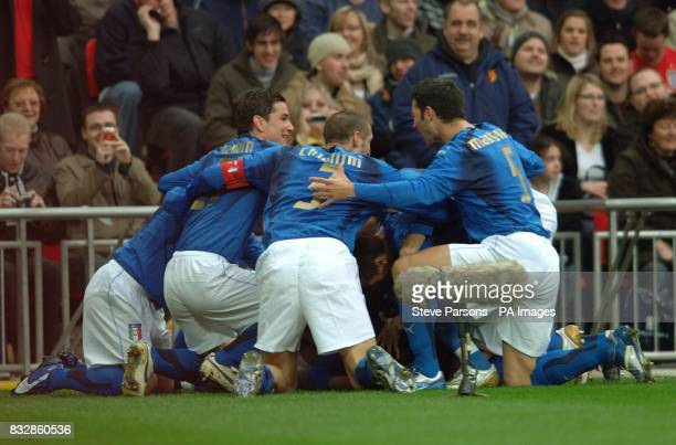 Italy players celebrate Giampaolo Pazzini's goal in the first minute of the game