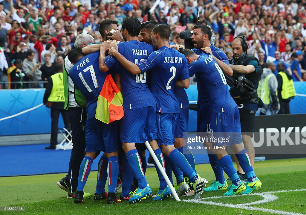 Italy players celebrate their team's first goal by Giorgio Chiellini (obscured) during the UEFA EURO 2016 round of 16 match between Italy and Spain at Stade de France on June 27, 2016 in Paris, France.