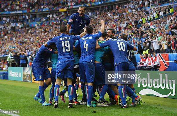 Italy players celebrate their team's second goal by Graziano Pelle during the UEFA EURO 2016 round of 16 match between Italy and Spain at Stade de...